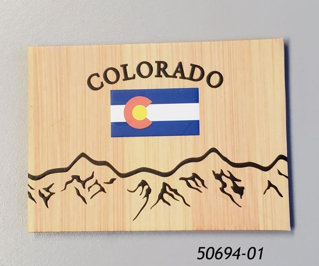 50694-01 Colorado souvenir magnet with wood grain look, flag and mountains graphic.