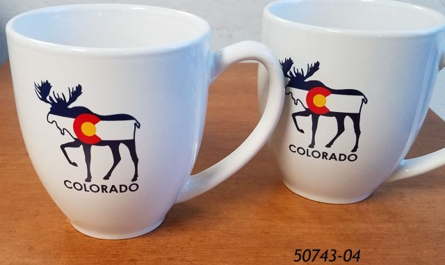 White rounded mug with souvenir Moose Colorado design.